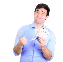 Portrait of young happy businessman holding money in his hands