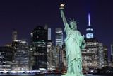 Manhattan Skyline and The Statue of Liberty at Night