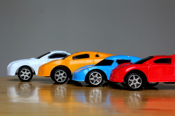 miniature colorful cars standing in line showroom sale concept