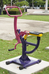Colorful exercise equipment in park.