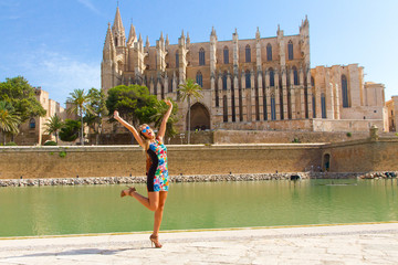 Happy tourist girl on mallorca - in Background Cathedral La Se