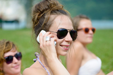 young woman on the phone at the beach