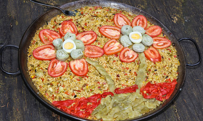 A decorated paella with flowers