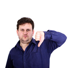Portrait of disappointed young businessman showing thumb down