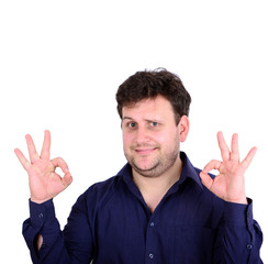 Portrait of handsome young man showing ok sign with hands isola