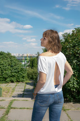 Young woman in summer park, bokeh