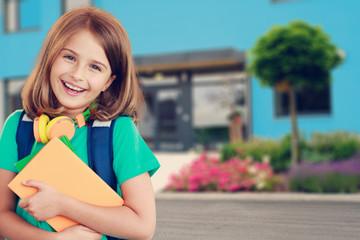 Back to school - portrait of beautiful young schoolgirl
