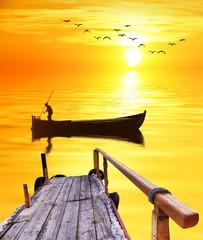 paisaje de un pescador en el amanecer