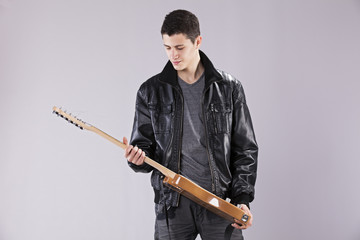 Teenager with an electric guitar