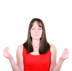 Young girl meditating over white background