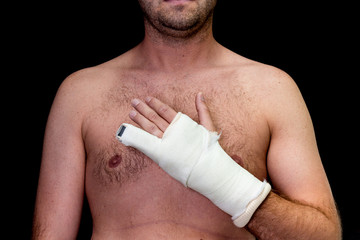 Man with little finger in cast