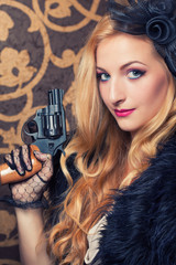 beautiful retro woman holding a revolver