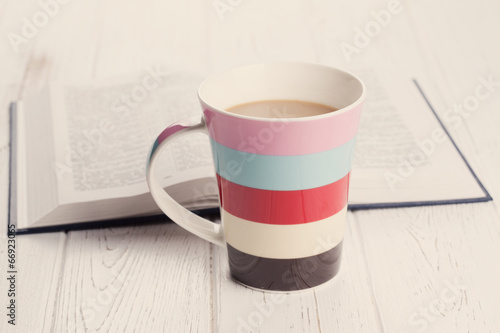 Canvas Cafe cup of coffee on wooden background