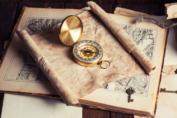 compass and old map on wooden table