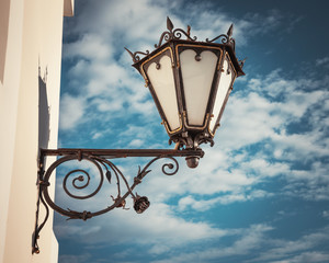 decorative  wall street lamp on blue sk