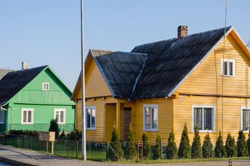 rural green yellow painted houses along street