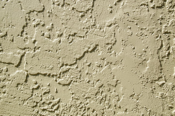 painted stucco wall abstract background in sunshine
