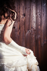 bride from back against wooden background