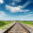 rail road to horizon under deep blue sky