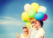 happy family with colorful balloons outdoors