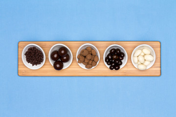 Taster dishes of assorted chocolates