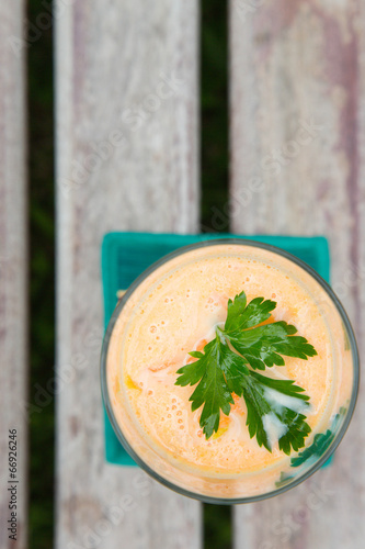 Carrot smoothie with fresh parsley leaves