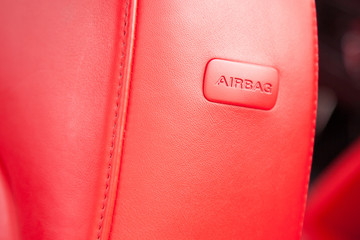 Side airbag in a car seat