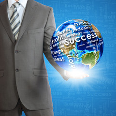 Businessman holds Earth in hand