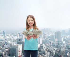 smiling little girl giving dollar cash money