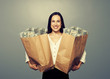 excited businesswoman with money