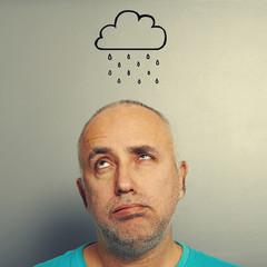 man with drawing storm cloud