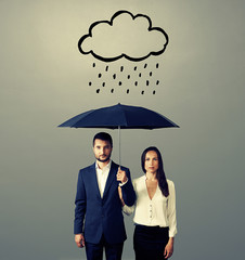 serious couple with black umbrella