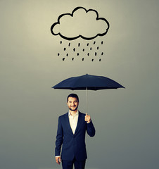 smiley businessman with black umbrella