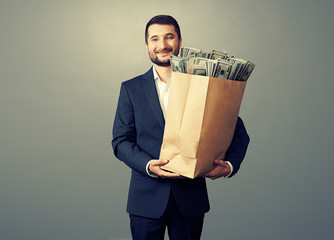 smiley man with money over grey