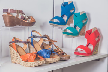 Sandals stand on a shelf