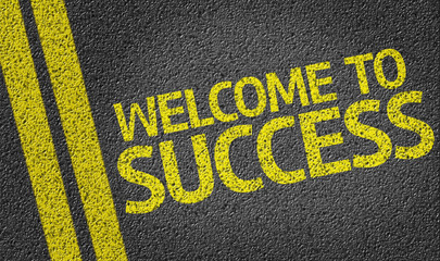 Welcome to Success written on the road