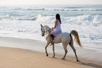 girl horse ride on the beach