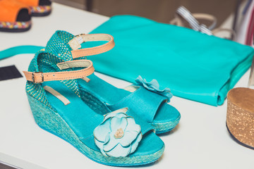 turquoise sandals and handbag