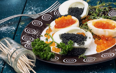 chicken egg with red and black caviar