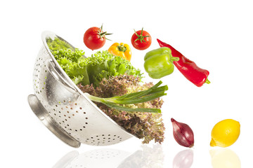 Colorful healthy fresh vegetables in strainer