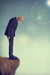 senior man on a cliff ledge