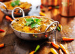 canvas print picture - saag paneer curry dish with cilantro garnish