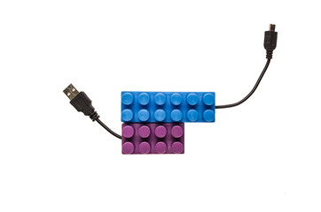 blue and purple building blocks with usb cables