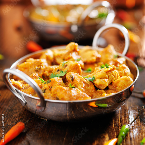 indian chicken curry in balti dish - 66931239