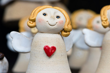 Cute ceramic angel with red heart