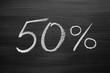 50-percent header written with a chalk on the blackboard