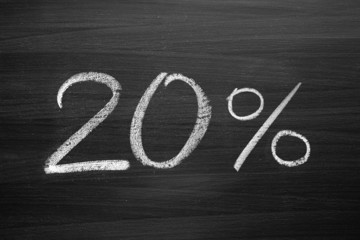 20-percent header written with a chalk on the blackboard