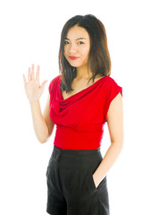 Young woman standing with her hands in pockets and gesturing