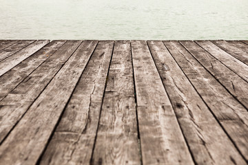 aged wooden pier background with water