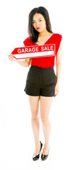 Saleswoman holding a Garage sale sign
